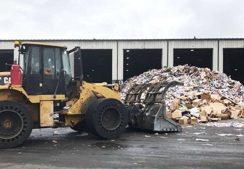 Plastic bags caught in conveyor belt at West Van Materials Recovery Center