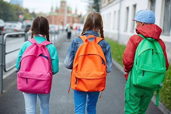 3-kids-walking-to-school-with-colorful-backpacks-view-from-behind-shutterstock_219008878