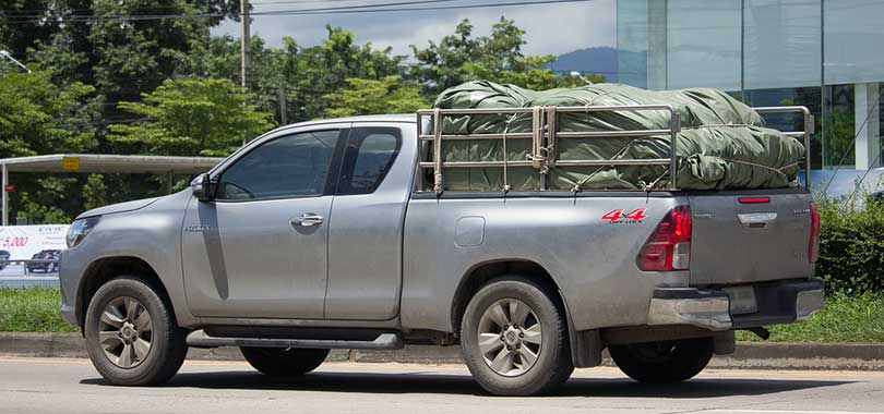 pickup carrying load covered with tarp